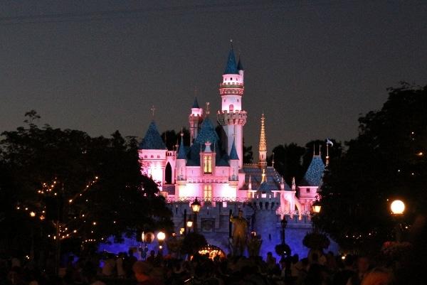 Sleeping Beauty Castle at Disneyland lit up at night