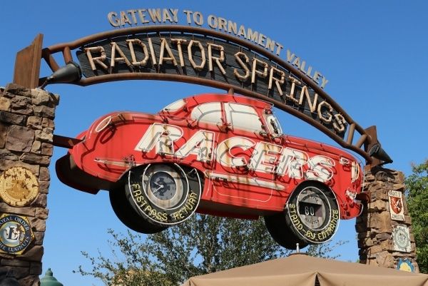 a large sign with a red car that says Radiator Springs Racers
