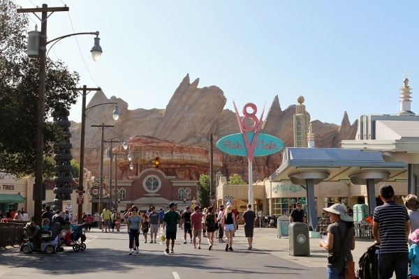 A group of people walking through Cars Land in Disney\'s California Adventure