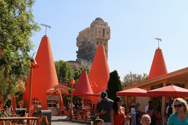 giant orange traffic cones with the Tower of Terror in the background