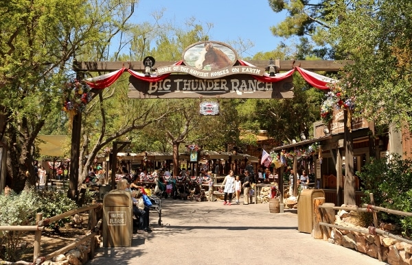 a sign that says Big Thunder Ranch over an entrance