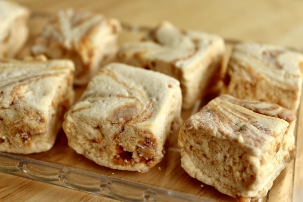 square marshmallows swirled with peanut butter arranged on a glass tray
