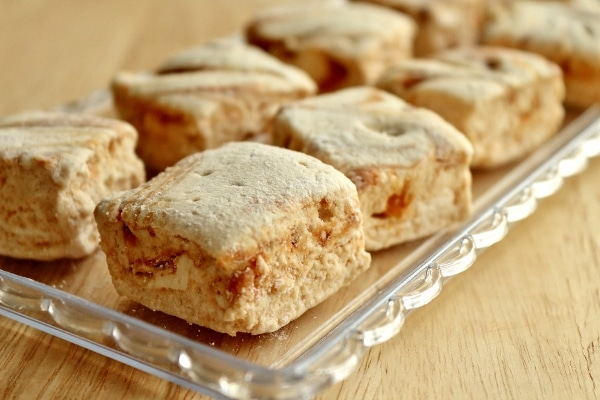 side view of a glass tray of square marshmallows with peanut butter swirls