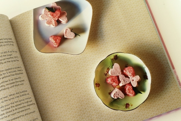tiny pink heart shaped marshmallows in small dishes