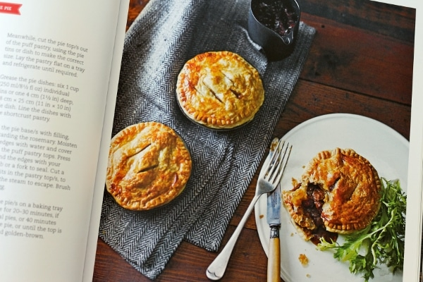 small savory pies on a white plate and blue cloth napkin