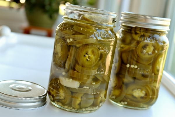 2 jars of homemade pickled jalapenos, 1 without a lid