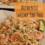 shrimp pad thai noodles topped with chopped peanuts on two square plates