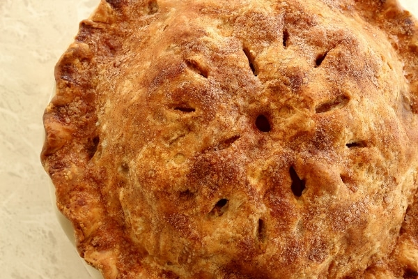 overhead closeup of a baked pie with a golden brown crust