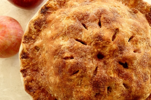 overhead closeup of a baked pie with slits in the top crust