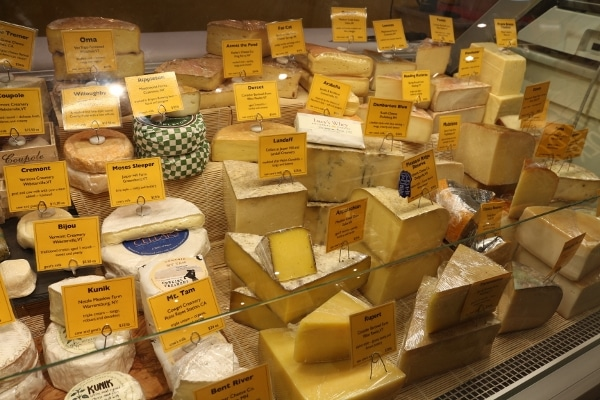 a display case of cheeses