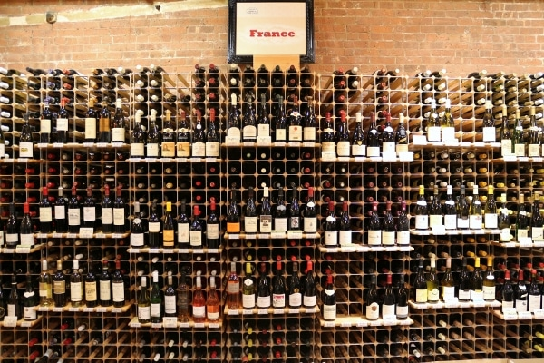 a wall with a grid filled with bottles of wine
