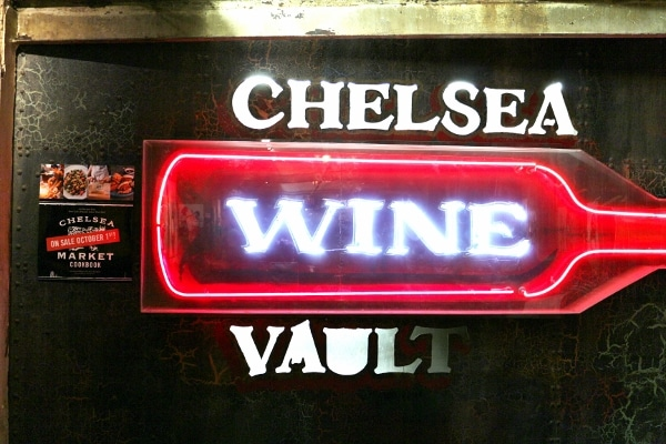 a lit up sign that says Chelsea Wine Vault