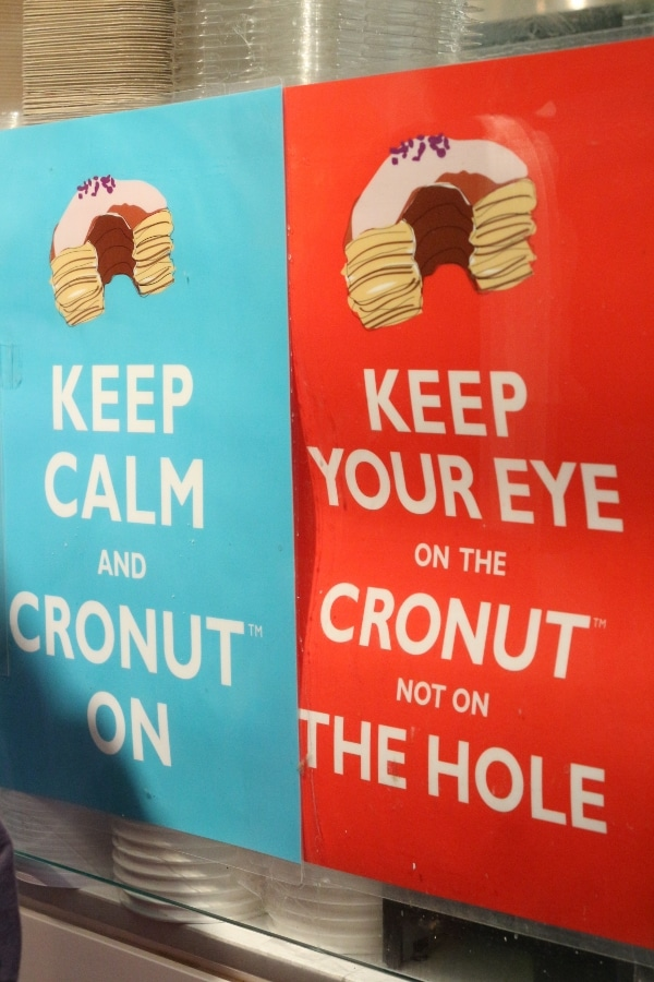 blue and red signs with images of Cronuts and text on them