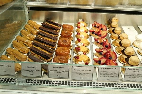 a bakery display case with a variety of desserts for sale