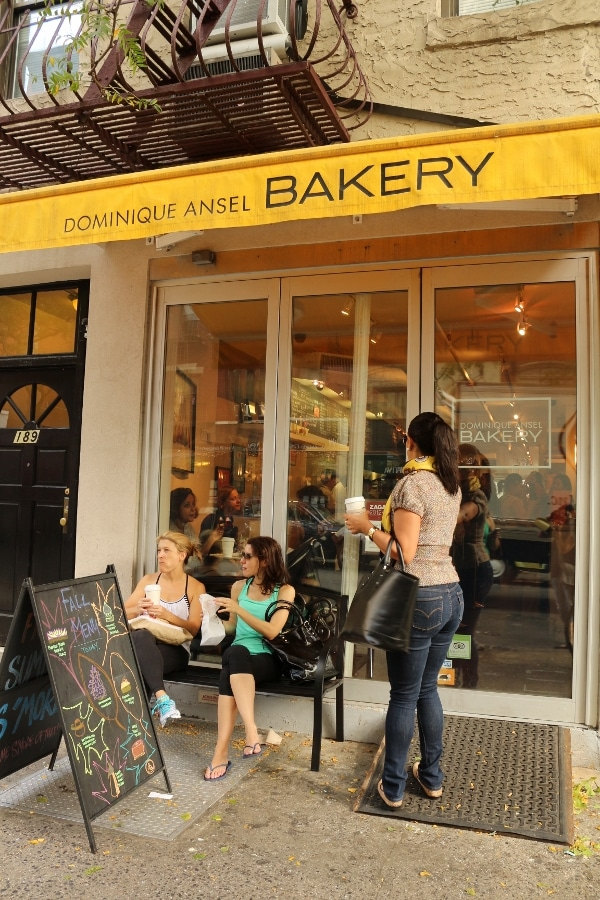 A group of people standing in front of the Dominique Ansel Bakery