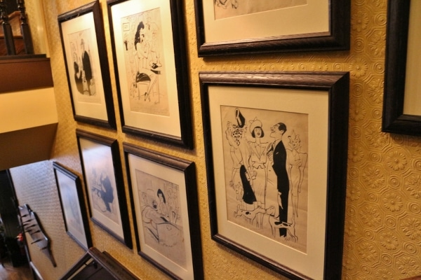 framed illustrations on a wall