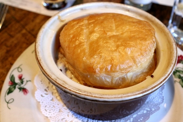 A closeup of a pot pie topped with a puff pastry round