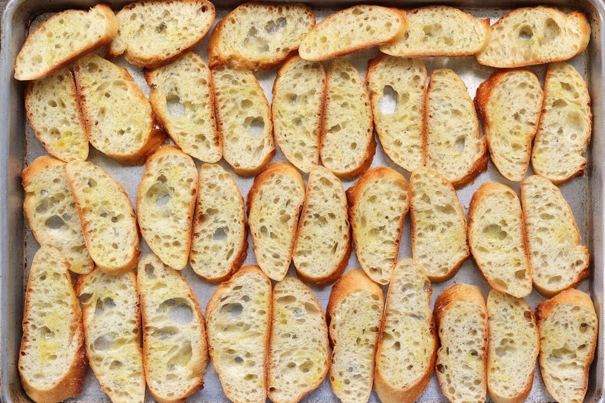 baguette slices arranged on a baking sheet