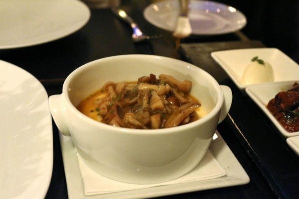 cooked mushrooms in a white bowl on a table