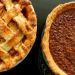 overhead view of an apple pie and a pecan pie side by side on a table