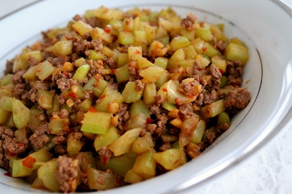 closeup of stir-fried celery and ground beef in a white bowl