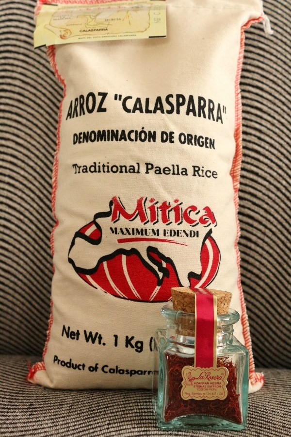 a large sac that says Arroz Calasparra Traditional Paella Rice, and a small jar of saffron