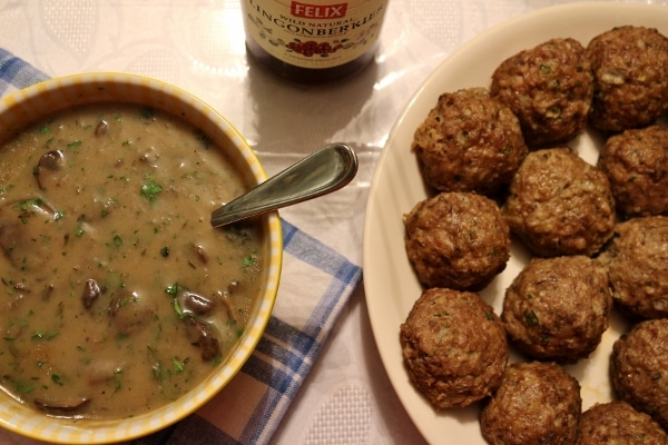 overhead view of a bowl of mushroom gravy and a platter of Swedish meatballs