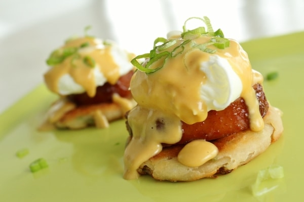 Asian Eggs Benedict, mini scallion pancakes topped with pork, poached egg, and Hoisin Hollandaise sauce