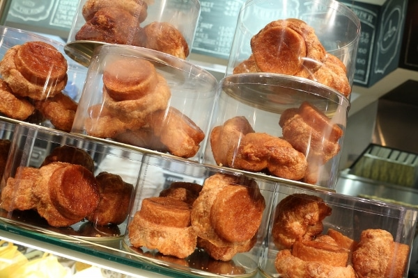 a store display with glass containers filled with pastries