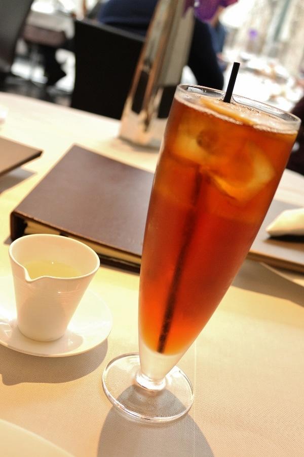 a tall glass of iced tea on a table