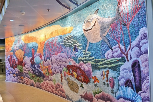 a colorful underwater themed tile mosaic with a shark, fish, and plants