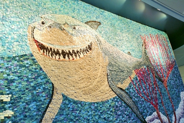 A closeup of a tile mosaic designed to look like a great white shark