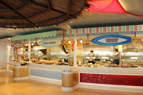 a beach themed restaurant buffet with surf board signs over each station