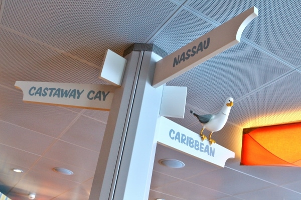 a directional sign pointing to Nassau, Caribbean, and Castaway Cay