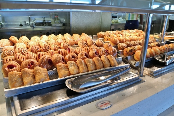 rows of breakfast pastries on a buffet