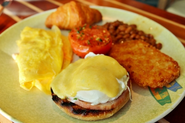 a closeup of a plate of breakfast foods including eggs benedict