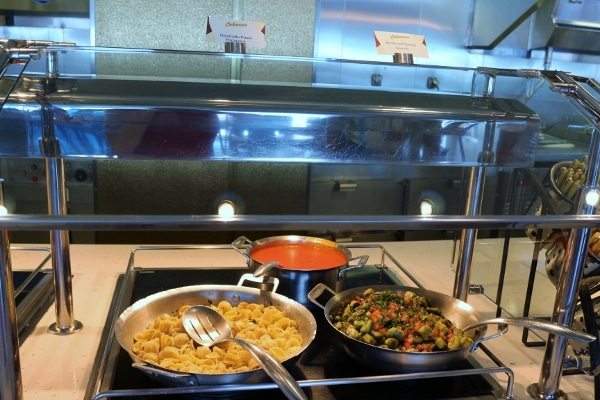 pans of food on a buffet