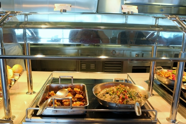two pans of food on a buffet line