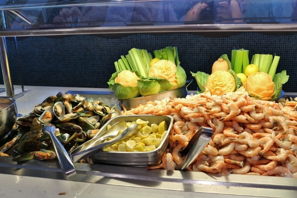 mussels, shrimp, and lemons set up on a cold buffet line