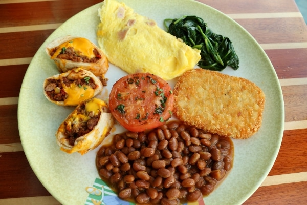 overhead view of a plate of breakfast foods from a buffet