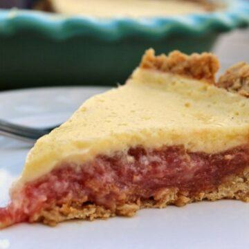 Rhubarb custard pie on a white plate