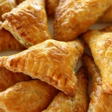 A platter of cheese borek triangles made with puff pastry