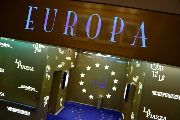 a sign that says Europa over a bank of elevators