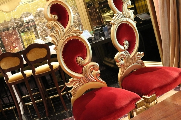 two red and gold regal looking chairs