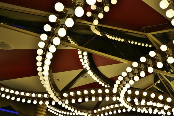 a closeup of bright light bulbs arranged in decorative rows overhead