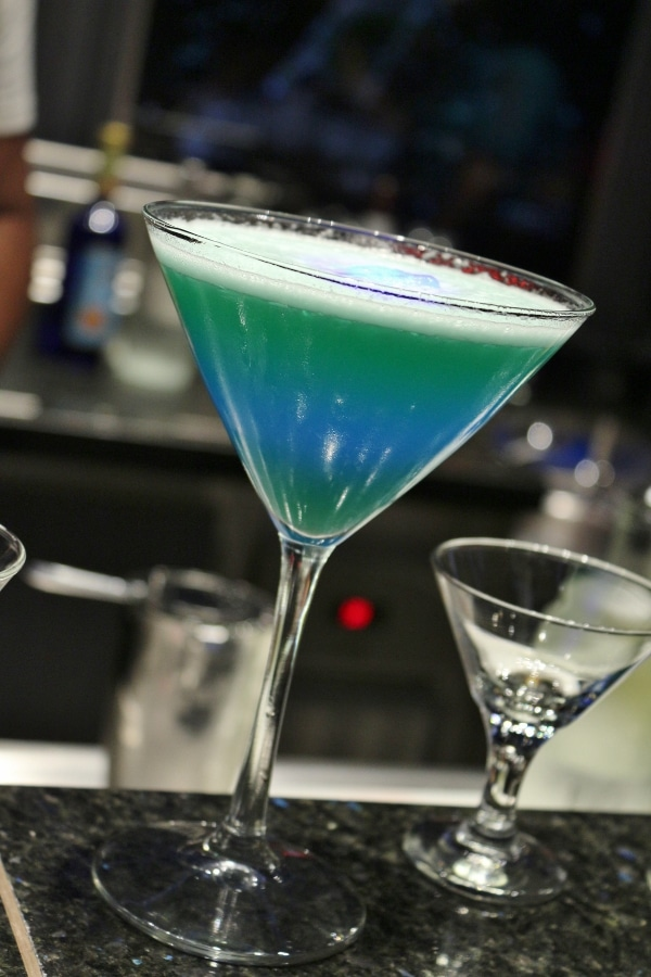 a blue and green drink in a cocktail glass