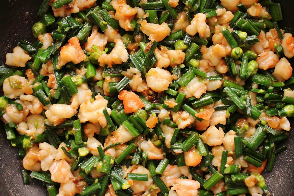 Closeup of shrimp and chive dumpling filling in a skillet.
