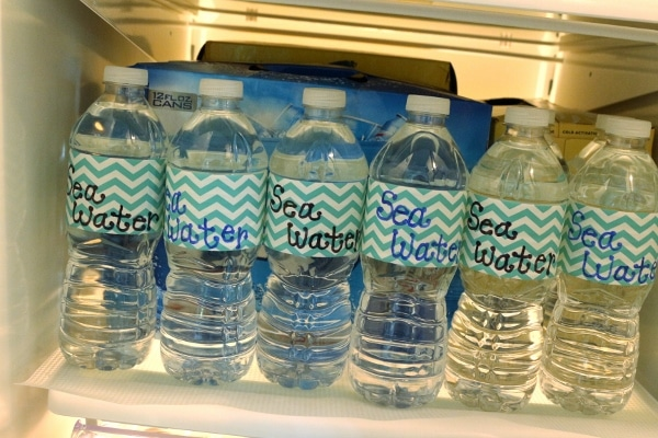 bottles of water in the refrigerator with labels that say Sea Water
