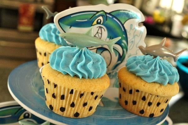 a closeup of cupcakes on a shark-themed cupcake display