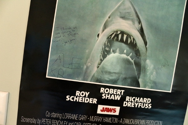 a closeup of a Jaws movie poster with writing on it